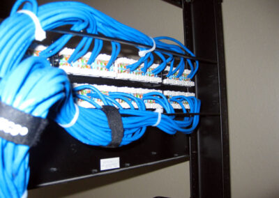 Back view of a properly terminated patch panel with our signature neatly tied network cables.