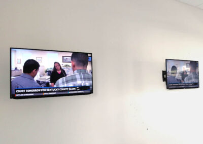 Ran cabling and mounted TVs on wall.